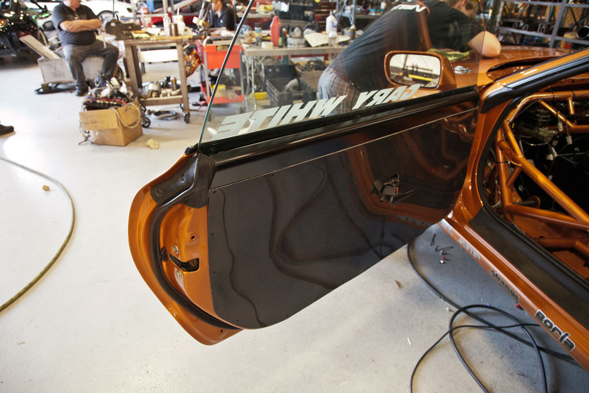 Decided to go with the carbon on the doors. Keeping it looking really nice & Titan Motorsports Copper Supra rebuild for 2012 - going for the ... Pezcame.Com